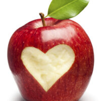 Red Apple with heart on white. This file is cleaned, retouched and contains clipping path.